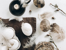 Easter Rustic Flat Lay. Natural Easter Eggs, Feathers, Pussy Willow, Candle On White Aged Table