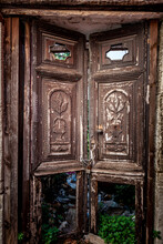 Old Traditional Wooden Door With Elaborate Relief Represantations, In An Abandoned House In Archanes Village, Near Heraklion City, In Crete Island, Greece, Europe
