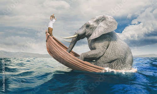 Fotografie, Obraz child on a shared boat with a big elephant.