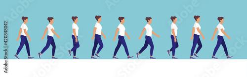 Obraz Woman walking cycle side view - fototapety do salonu