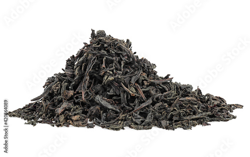 Fototapeta Dry black tea leaves isolated on a white background. Pile of black tea. Large leaf black tea. obraz
