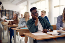 African American Student Feeling Bored While Attending Class At Lecture Hall.