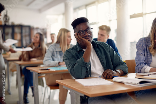 Fotografie, Obraz African American student feeling bored while attending class at lecture hall