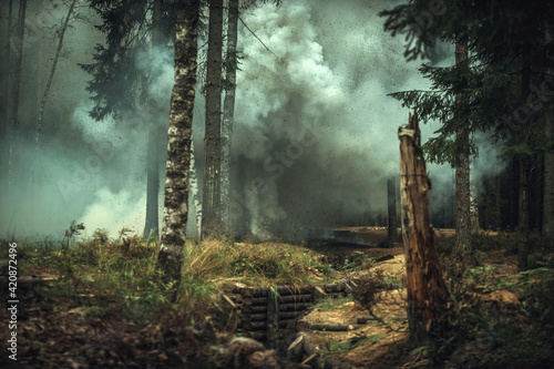 Fototapeta The explosion of a shell in the forest against the background of the trenches of the Finnish army during the Second World War