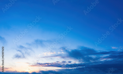 Canvas Print sunrise on blue sky. Blue sky with some clouds