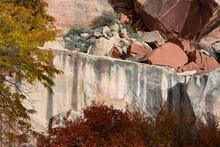 USA, Utah. Sandstone Cliff Face, Boulders, And Autumn Vegetation, Capital Reef National Park.