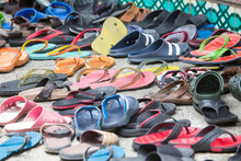 Rows Of Footwear And Flip Flops On Sidewalk Outside Mosque,  Malacca, Malaysia