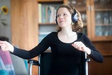 Woman In Wheelchair Dancing To Music On Headphones