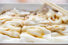 Side View Traditonal Cantonese Food Of Cheong Fun Or Rice Noodle Rolls Close Up Horizontal Composition