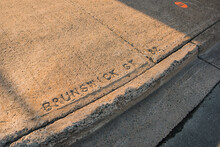 Words 'Brunswick St' Engraved On Pavement, Halifax, Canada