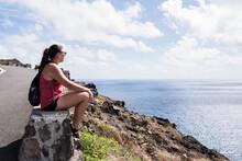 Hiker On Stone Wall Enjoying View Of Sea, Makapuu'u, Oahu, Hawaii