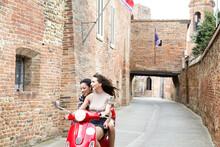 Friends Exploring On Scooter,  Città Della Pieve, Umbria, Italy
