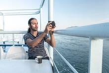 Man On Cruise Boat Taking Photograph