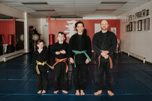 Coaches And Students Posing In Martial Arts Studio