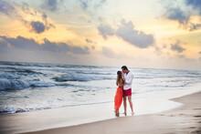 Young Couple Kissing On Beach At Sunset, Hikkaduwa, Southern, Sri Lanka