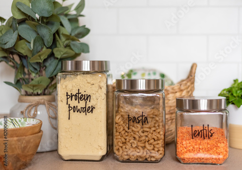 Fotografering Glass canisters to store dry foods in the kitchen
