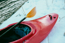 Kayak And Paddle On Riverbank In Winter, Cropped