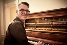 Man Smiling And Playing Piano