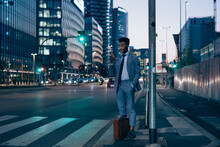 Businessman Using Smartphone By Pedestrian Crossing, Milano, Lombardia, Italy