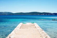 Scenic View Of Pier And Blue Sea, Alghero, Sardinia, Italy