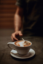 Barista At Cafe Counter With Cup Of Mocha Topped With Toasted Marshmallow, Cropped Shallow Focus