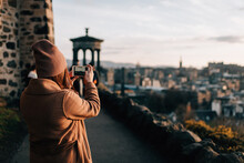 Woman Taking Photo From Calton Hill, Edinburgh, Scotland