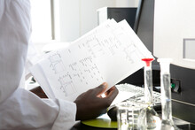 Young Female Scientist Looking At Results In Laboratory, Cropped