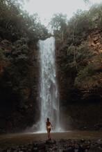 Woman Enjoying Waterfall, Princeville, Hawaii, US