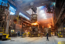 Steelworkers Pouring Molten Steel In Melt Shop Of Steelworks