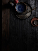 Snuff Bottles, Small Dishes, Dabber Tool On Wooden Table