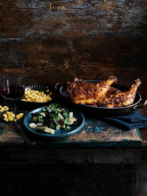 Rustic Still Life With Chipotle Chicken, Corn And Rainbow Chard On Wooden Table