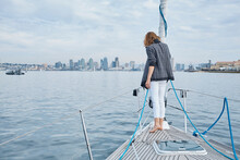 Woman Enjoying Sea View On Bow Of Sailboat, San Diego, California, USA