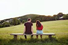 Couple Sitting On Bench Overlooking Hills, Wilhelminenberg, Vienna, Austria