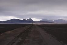 Off Road Vehicle On Dirt Track Heading To Hills, Landmannalaugar, Iceland