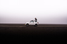 Woman Photographing From Top Of Off Road Vehicle, Landmannalaugar, Iceland