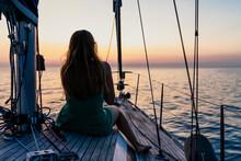 Woman Enjoying Sunset On Sailboat, Italy