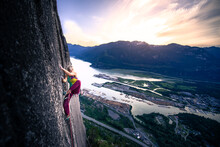 Rock Climber On Rock Face Of Heatwave At Sunrise, The Chief, Squamish, Canada