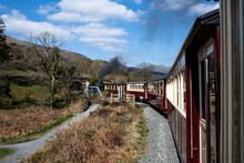 Steam Train Passing Through Countryside, Llanaber, Gwynedd, United Kingdom