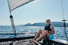 Woman On Sailboat In Sea Off Paleros, Greece