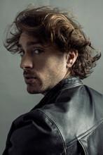 Man In Leather Jacket Turning Around Surprised, Grey Background