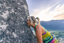 Happy Rock Climber Kissing Rock Face Of Heatwave, The Chief, Squamish, Canada