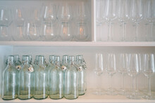 Shelves Of Wine Glasses And Glass Bottles
