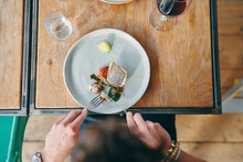 Man Having Meal In Restaurant