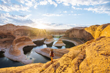 Backpacker At Sunrise, Reflection Canyon, Lake Powell, Utah, US