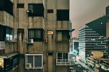 Dirty Old Apartment Block And Modern Office Buildings, Kaohsiung, Taiwan