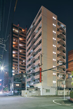 Modern Apartment Building Blocks At Night In Osaka, Japan