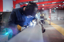 Argon Welder Welding Pipe In Metal Fabrication Factory.