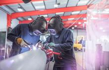 Argon Welders Welding Pipe In Metal Fabrication Factory.