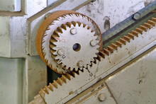 Close Up Of Old Wooden Cogwheel In Abandoned Factory.