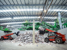Diggers With Waste Paper In Waste Recycling Plant.